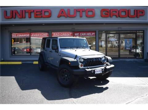 2013 Jeep Wrangler Unlimited for sale at United Auto Group in Putnam CT