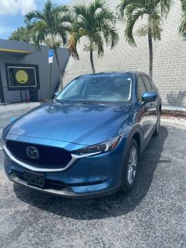 2021 Mazda CX-5 for sale at YOUR BEST DRIVE in Oakland Park FL