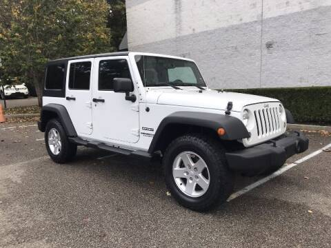 2014 Jeep Wrangler Unlimited for sale at Select Auto in Smithtown NY