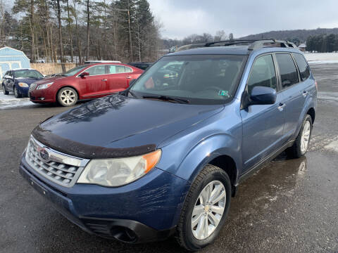 2012 Subaru Forester for sale at BURNWORTH AUTO INC in Windber PA
