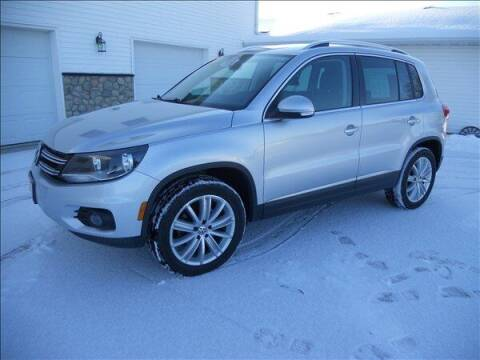 2012 Volkswagen Tiguan for sale at OLSON AUTO EXCHANGE LLC in Stoughton WI
