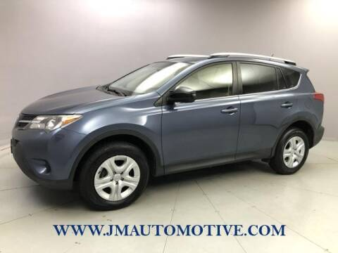 2014 Toyota RAV4 for sale at J & M Automotive in Naugatuck CT