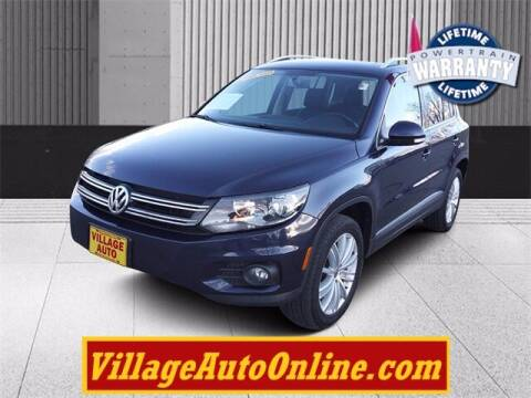 2015 Volkswagen Tiguan for sale at Village Auto in Green Bay WI