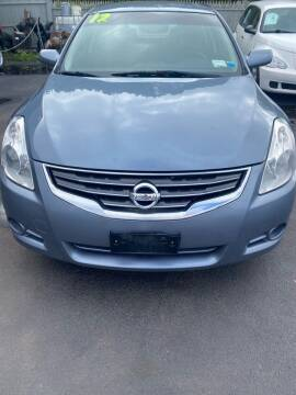 2012 Nissan Altima for sale at Right Choice Automotive in Rochester NY
