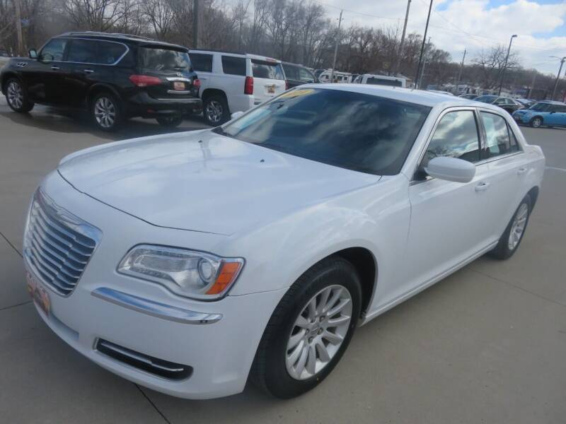 2014 Chrysler 300 for sale at Azteca Auto Sales LLC in Des Moines IA