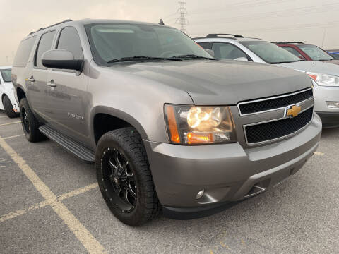 2009 Chevrolet Suburban for sale at BELOW BOOK AUTO SALES in Idaho Falls ID