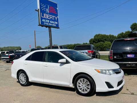 2014 Toyota Camry for sale at Liberty Auto Sales in Merrill IA