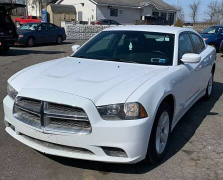 2014 Dodge Charger for sale at Kingz Auto Sales in Avenel NJ