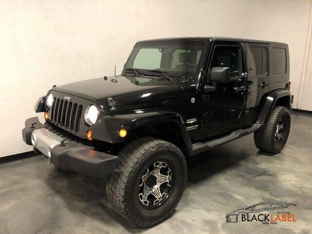 2010 Jeep Wrangler Unlimited for sale at BLACK LABEL AUTO FIRM in Riverside CA