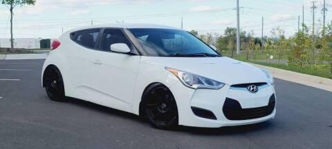 2013 Hyundai Veloster for sale at BOOST MOTORS LLC in Sterling VA