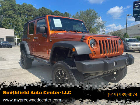 2011 Jeep Wrangler Unlimited for sale at Smithfield Auto Center LLC in Smithfield NC