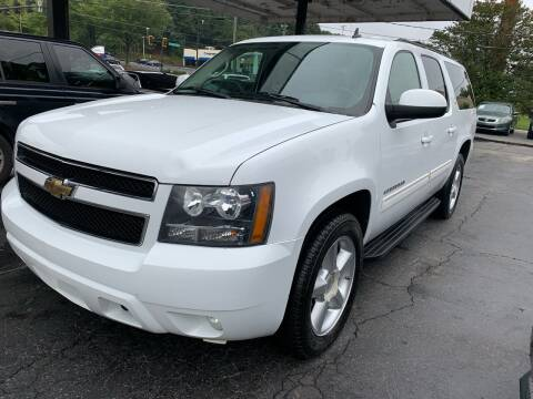 2011 Chevrolet Suburban for sale at Magic Motors Inc. in Snellville GA