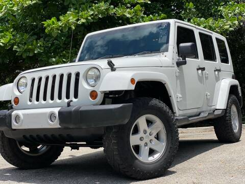 2010 Jeep Wrangler Unlimited for sale at HIGH PERFORMANCE MOTORS in Hollywood FL