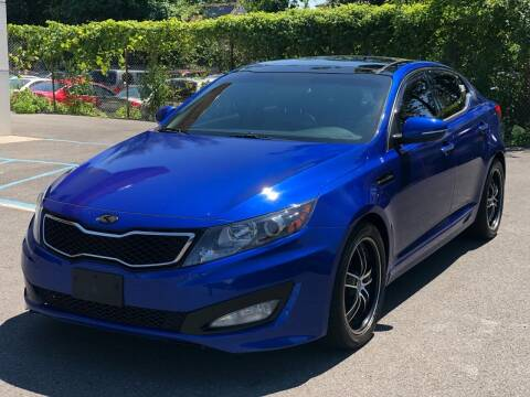 2011 Kia Optima for sale at MAGIC AUTO SALES in Little Ferry NJ