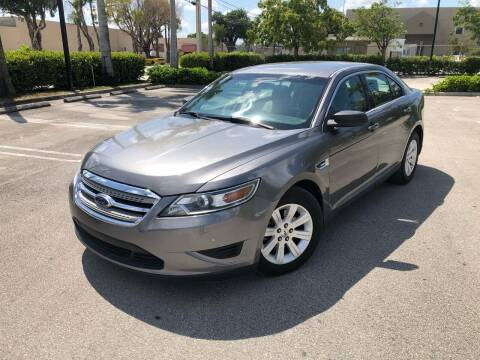 2012 Ford Taurus for sale at Auto Credit & Finance Corp. in Miami FL