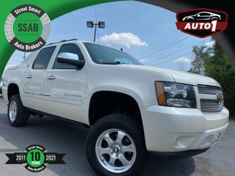 2013 Chevrolet Avalanche for sale at Street Smart Auto Brokers in Colorado Springs CO