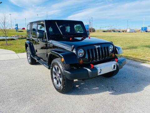 2013 Jeep Wrangler Unlimited for sale at Airport Motors in Saint Francis WI