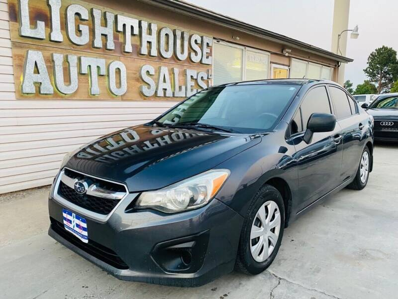 2014 Subaru Impreza for sale at Lighthouse Auto Sales LLC in Grand Junction CO