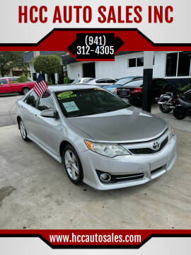 2014 Toyota Camry for sale at HCC AUTO SALES INC in Sarasota FL