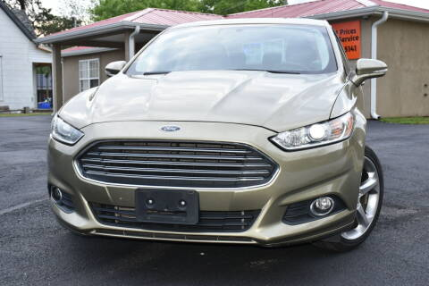 2013 Ford Fusion for sale at JE AUTO SALES LLC in Webb City MO
