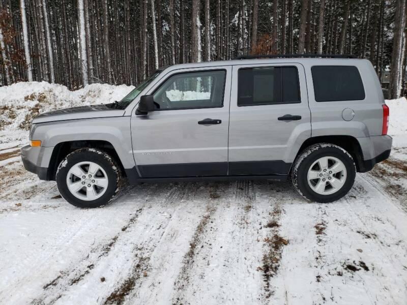 2016 Jeep Patriot for sale at McLain's Auto Sales in Lake City MI