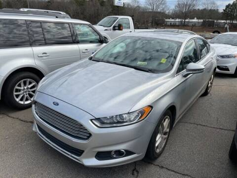 2015 Ford Fusion for sale at BILLY HOWELL FORD LINCOLN in Cumming GA