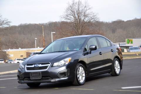 2014 Subaru Impreza for sale at T CAR CARE INC in Philadelphia PA