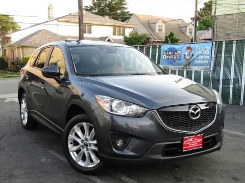 2014 Mazda CX-5 for sale at The Auto Network in Lodi NJ