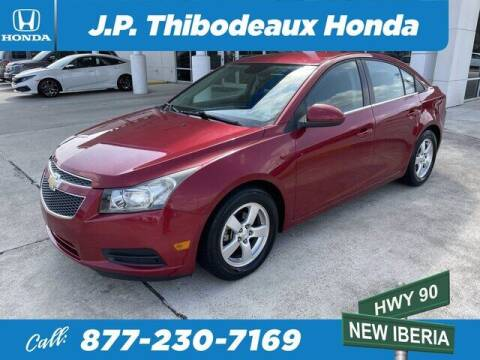 2013 Chevrolet Cruze for sale at J P Thibodeaux Used Cars in New Iberia LA
