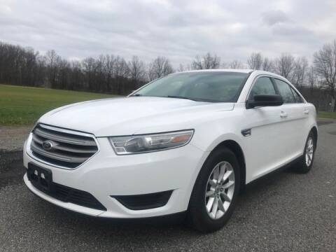 2013 Ford Taurus for sale at GOOD USED CARS INC in Ravenna OH