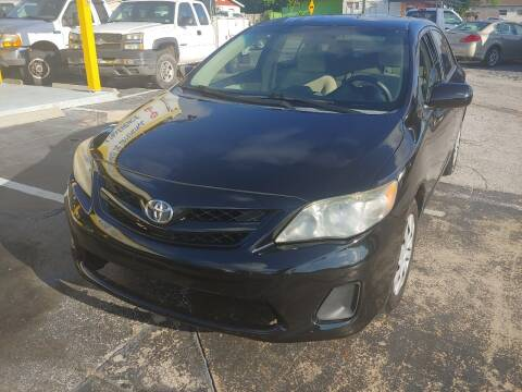 2013 Toyota Corolla for sale at Autos by Tom in Largo FL