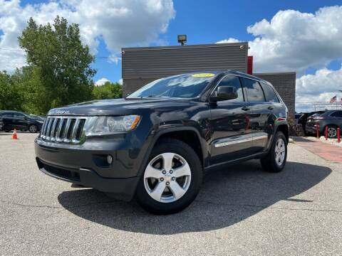 2011 Jeep Grand Cherokee for sale at George's Used Cars - Telegraph in Brownstown MI
