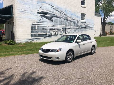 2009 Subaru Impreza for sale at PUTNAM AUTO SALES INC in Marietta OH