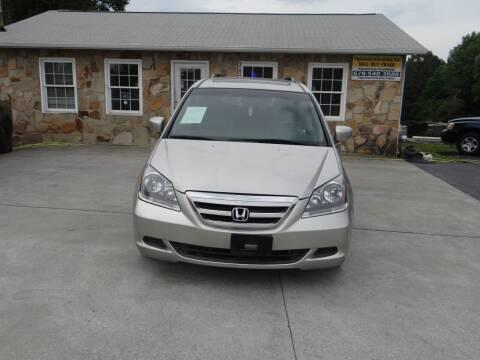 2006 Honda Odyssey for sale at Flywheel Auto Sales Inc in Woodstock GA
