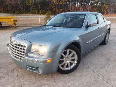 2009 Chrysler 300 for sale at GEORGIA AUTO DEALER, LLC in Buford GA