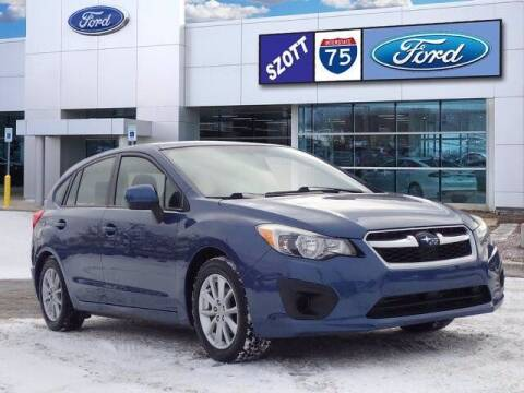 2013 Subaru Impreza for sale at Szott Ford in Holly MI