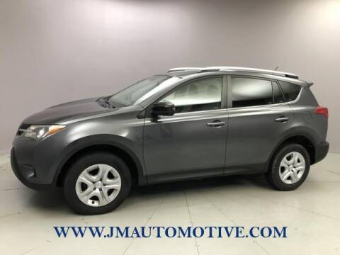 2013 Toyota RAV4 for sale at J & M Automotive in Naugatuck CT