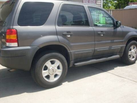 2003 Ford Escape for sale at Flag Motors in Islip Terrace NY