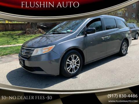 2012 Honda Odyssey for sale at FLUSHIN AUTO in Flushing NY