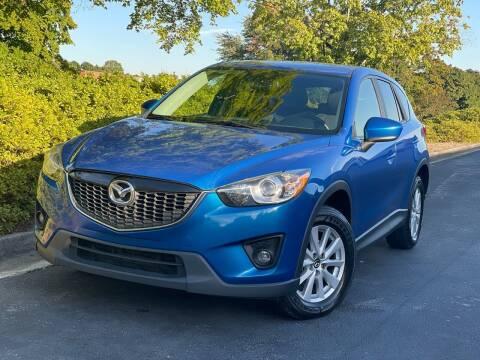 2013 Mazda CX-5 for sale at William D Auto Sales in Norcross GA