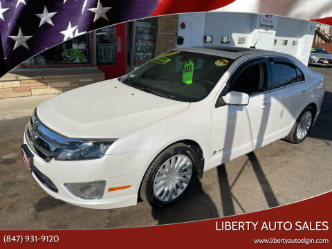 2012 Ford Fusion Hybrid for sale at Liberty Auto Sales in Elgin IL