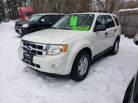 2009 Ford Escape for sale at Northwoods Auto & Truck Sales in Machesney Park IL