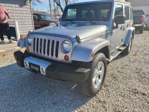 2013 Jeep Wrangler Unlimited for sale at Davidson Auto Deals in Syracuse IN