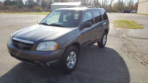 2003 Mazda Tribute for sale at Caruzin Motors in Flint MI