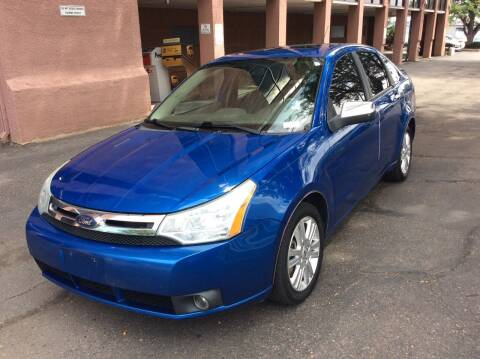 2010 Ford Focus for sale at AROUND THE WORLD AUTO SALES in Denver CO