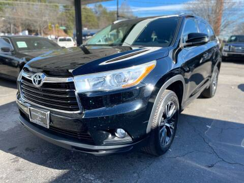 2016 Toyota Highlander for sale at Magic Motors Inc. in Snellville GA