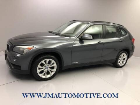 2014 BMW X1 for sale at J & M Automotive in Naugatuck CT
