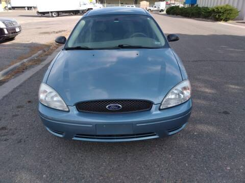 2005 Ford Taurus for sale at QUEST MOTORS in Englewood CO