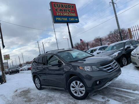 2013 Honda CR-V for sale at Dymix Used Autos & Luxury Cars Inc in Detroit MI