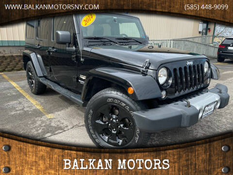 2014 Jeep Wrangler Unlimited for sale at BALKAN MOTORS in East Rochester NY